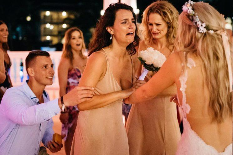 This bride planned a surprise proposal for her best friend. [Photo: Ross Dance Photography]