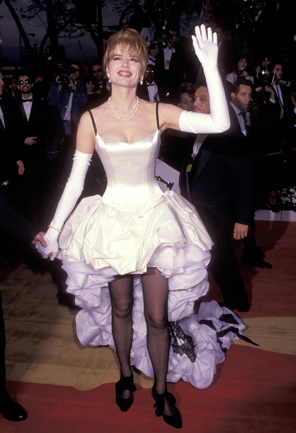 <p>Geena Davis gave us a '90s princess vibes at the 64th Academy Awards with a long ruffly dress train. The <strong>Thelma and Louise</strong> actress complemented her outfit with pearls, sheer tights, white gloves, and whimsical black shoes for a glam-punk look.</p>