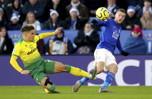 Norwich City's Max Aarons, left, and Leicester City's Jamie Vardy during their English Premier League soccer match at King Power Stadium in Leicester, England, Saturday Dec. 14, 2019. (Nick Potts/PA via AP)