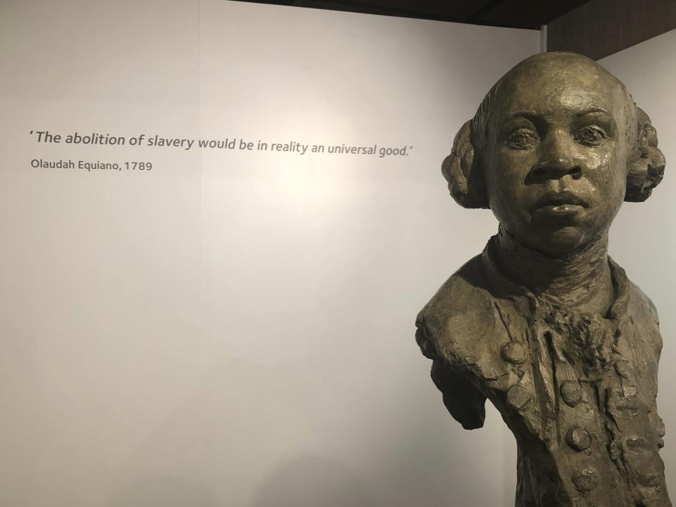 In this Nov. 24, 2019 photo, a sculpture of former slave and later abolitionist writer Olaudah Equiano is displayed at the International Slavery Museum in Liverpool, England. The museum seeks to tell the story of the enslavement of people from Africa and how the British city benefited from human bondage. (AP Photo/Russell Contreras)