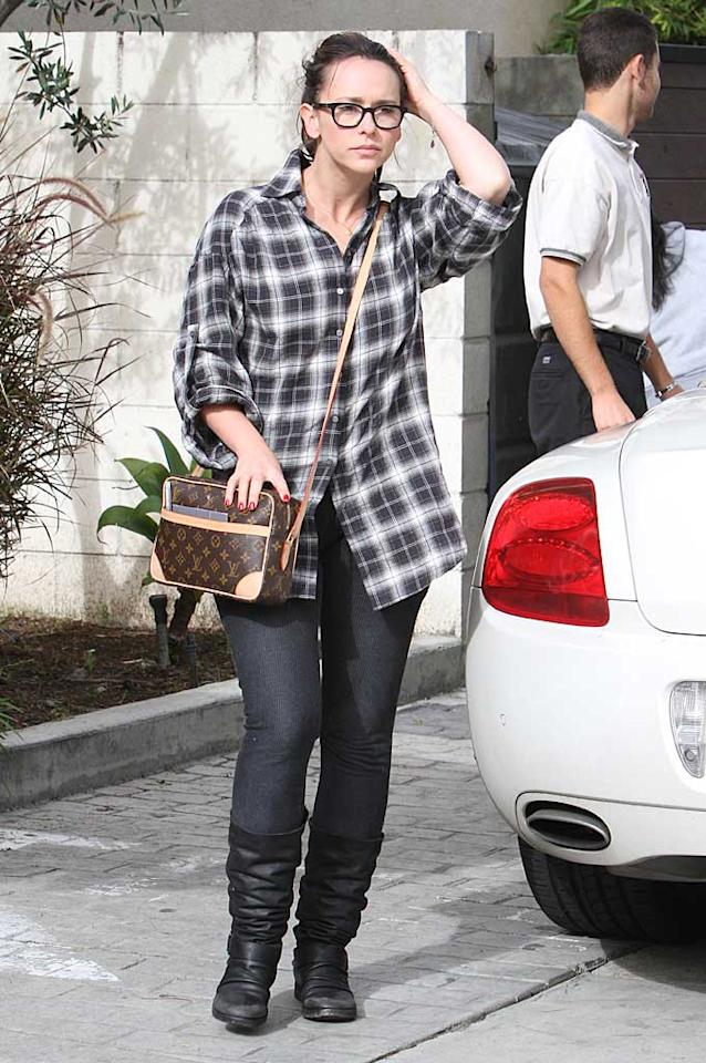 """A bespectacled Jennifer Love Hewitt accessorized her oversize plaid top with a Louis Vuitton bag and some slouchy boots. Is her look hot ... or not? Araujo/<a href=""""http://www.splashnewsonline.com"""" target=""""new"""">Splash News</a> - December 26, 2010"""