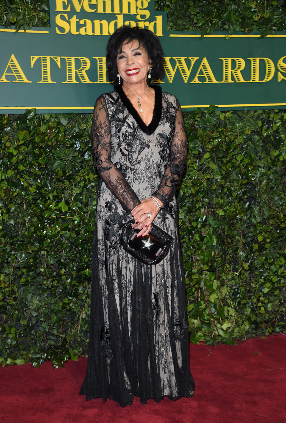 <p>Everyone's favourite dame was all smiles in a lacy black gown. <i>[Photo: Getty]</i> </p>
