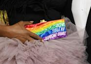 US actress Laverne Cox arrives at the Emmys carrying a rainbow clutch with a message