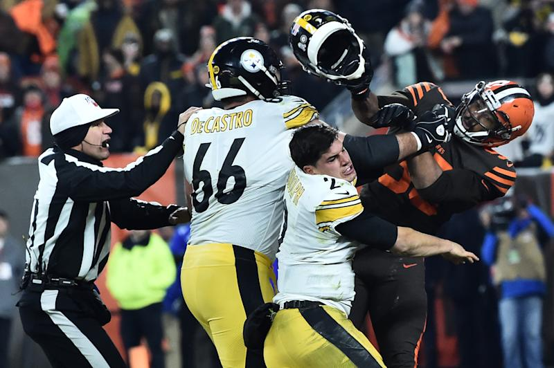 Nov 14, 2019; Cleveland, OH, USA; Cleveland Browns defensive end Myles Garrett (95) hits Pittsburgh Steelers quarterback Mason Rudolph (2) with his own helmet as offensive guard David DeCastro (66) tries to stop Garrett during the fourth quarter at FirstEnergy Stadium. Mandatory Credit: Ken Blaze-USA TODAY Sports