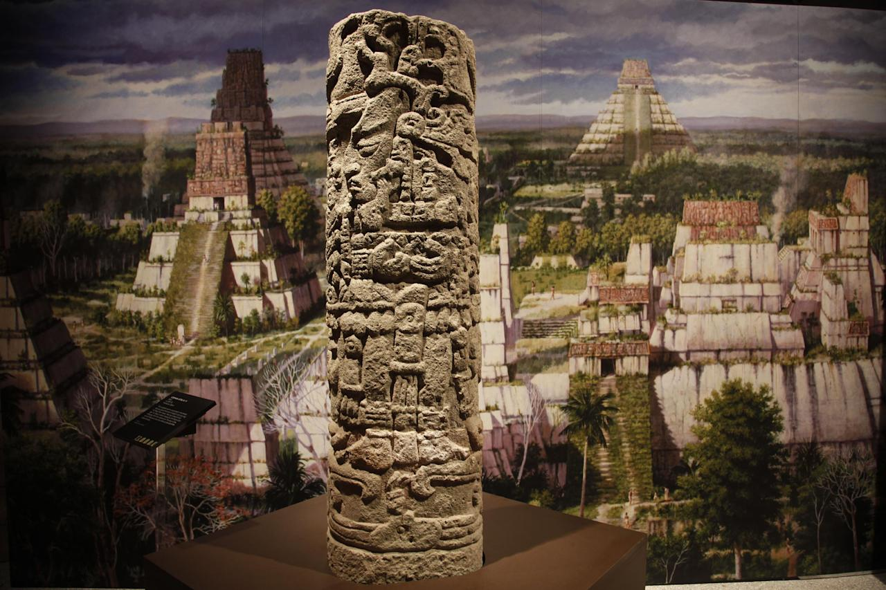 The stone Copan Stela 11 is shown at the Maya 2012: Lords of Time exhibit at the University of Pennsylvania Museum of Archaeology and Anthropology Thursday, May 3, 2012, in Philadelphia. The exhibit is scheduled to open May 5. (AP Photo/Matt Rourke)