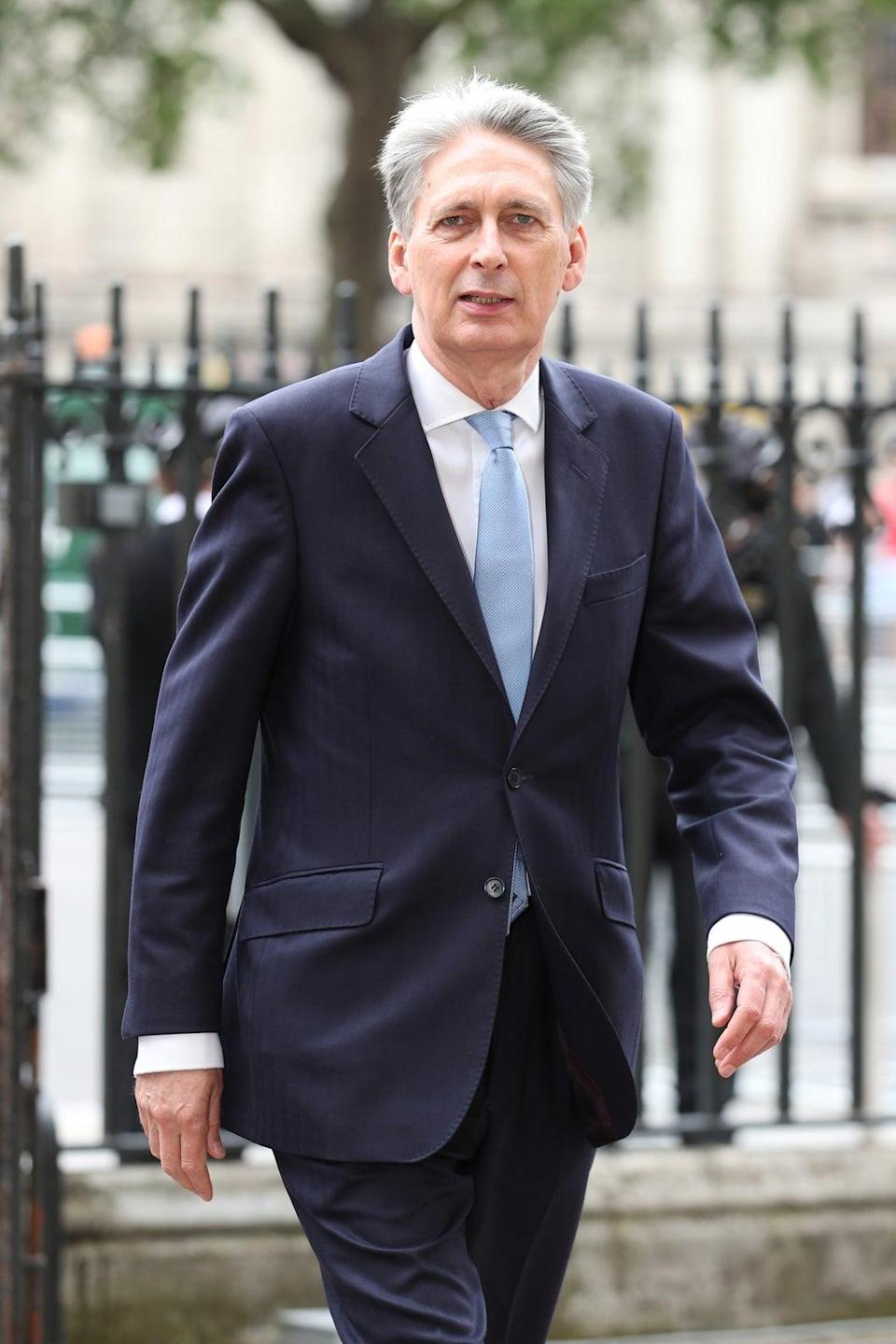 Former Tory chancellor Lord Hammond has warned that Boris Johnson's plans to increase National Insurance to pay for social care are 'wrong' and will provoke a 'very significant backlash' (Yui Mok/PA) (PA Archive)