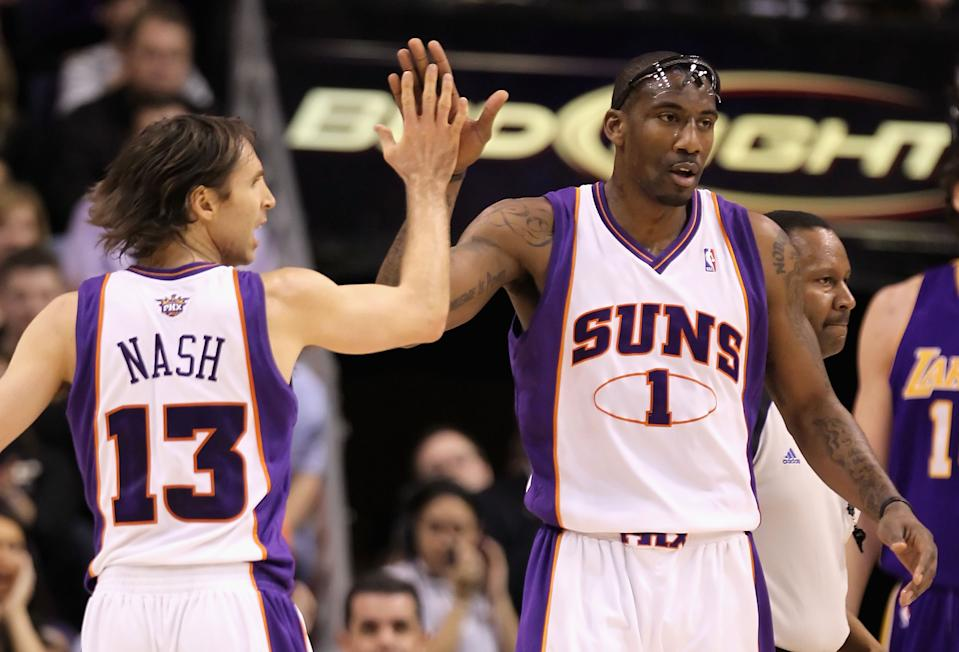 Amar'e Stoudemire and Steve Nash high-five during an NBA game.