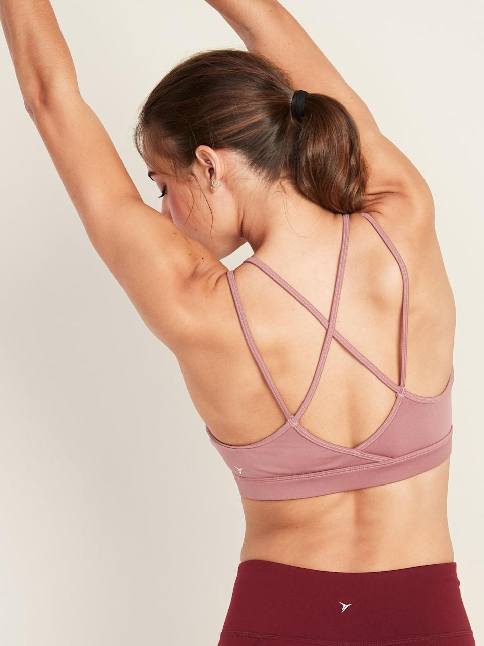 """<p>Because I have a smaller bust and don't need much support, this <a href=""""https://www.popsugar.com/buy/Old-Navy-Light-Support-Strappy-Sports-Bra-547986?p_name=Old%20Navy%20Light%20Support%20Strappy%20Sports%20Bra&retailer=oldnavy.gap.com&pid=547986&price=17&evar1=fit%3Aus&evar9=47449829&evar98=https%3A%2F%2Fwww.popsugar.com%2Fphoto-gallery%2F47449829%2Fimage%2F47449830%2FOld-Navy-Light-Support-Strappy-Sports-Bra&list1=old%20navy%2Cfitness%20gear&prop13=api&pdata=1"""" class=""""link rapid-noclick-resp"""" rel=""""nofollow noopener"""" target=""""_blank"""" data-ylk=""""slk:Old Navy Light Support Strappy Sports Bra"""">Old Navy Light Support Strappy Sports Bra</a> ($17, originally $20) is my favorite. Its lightweight and comfortable design is exactly what I need for low-intensity workouts like yoga. Plus, it comes in several colors, and I love the cute back design.</p>"""