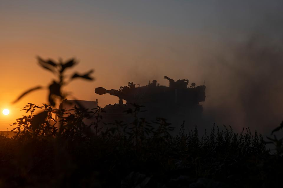 A truck carries an Israeli artillery unit to a position in the Israeli Gaza border, Thursday, May 13, 2021. (AP Photo/Ariel Schalit) (Photo: Ariel Schalit via AP)