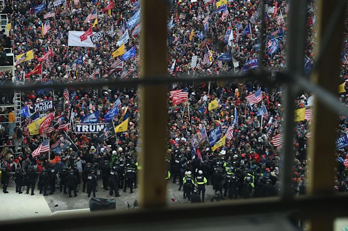 Supporters of US President Donald Trump gather outside the US Capitol's Rotunda on January 6, 2021, in Washington, DC. Demonstrators breeched security and entered the Capitol as Congress debated the a 2020 presidential election Electoral Vote Certification.