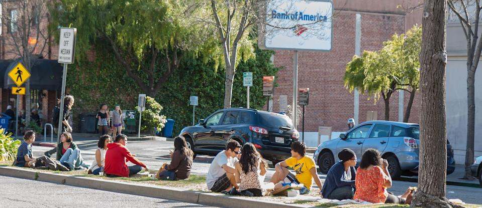 Berkeley diners feast on takeout on a highway median, a popular spot for picnics.