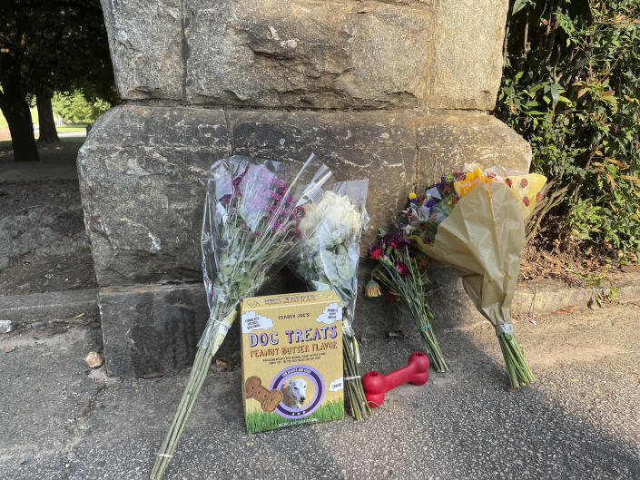 This photo shows a memorial at the Piedmont Park, Wednesday, July 28, 2021 in Atlanta. Authorities are searching for the person who fatally stabbed a woman who was walking her dog in Piedmont Park, one of Atlanta's most popular parks. Katherine Janness, 40, was found dead in Piedmont Park around 1 a.m. Wednesday, police said. Her dog had also been killed. (AP Photo/R.J. Rico)