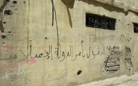 "Grafitti on Our Lady cathedral, Mosul, Iraq, reads ""Entry forbidden upon the order of the Islamic state"" - Credit: Tim Stanley"