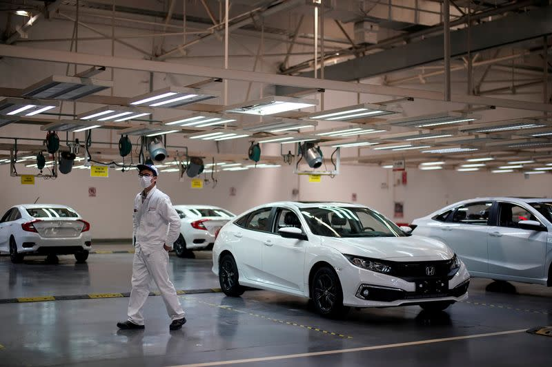 FILE PHOTO: Employee is seen on a production line inside a Dongfeng Honda factory in Wuhan