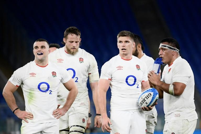 """Wait and see,"" says England captain Owen Farrell (C) of their Six Nations hopes."