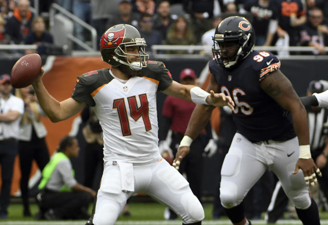 Tampa Bay Buccaneers quarterback Ryan Fitzpatrick (14) throws as Chicago Bears defensive end Akiem Hicks (96) pressures him during the first half of an NFL football game Sunday, Sept. 30, 2018, in Chicago. (AP Photo/David Banks)