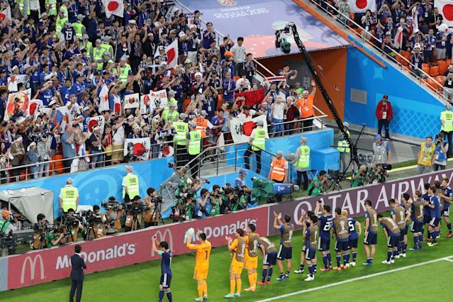 Soccer Football - World Cup - Group H - Japan vs Senegal - Ekaterinburg Arena, Yekaterinburg, Russia - June 24, 2018 Japan players applaud their fans after the match REUTERS/Marcos Brindicci