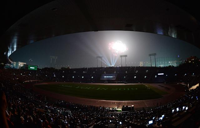 A fireworks display is seen over Japan's national stadium during the stadium's official farewell event in Tokyo on May 31, 2014 (AFP Photo/Toshifumi Kitamura)