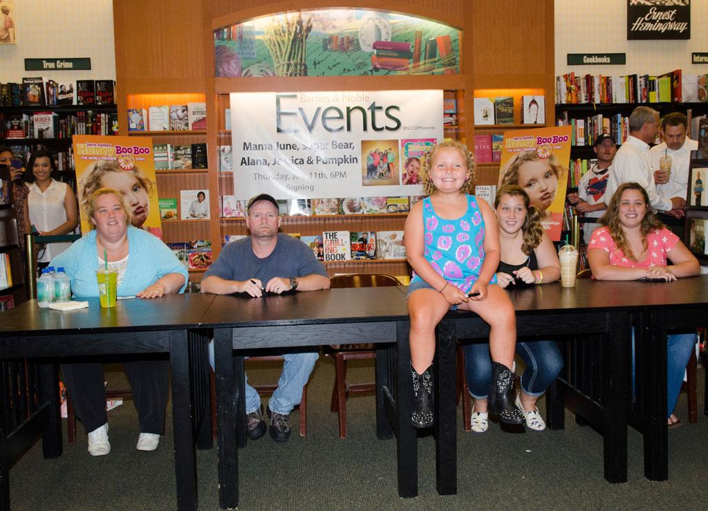 "June ""Mama"" Shannon, Mike ""Sugar Bear"" Thompson, Alana ""Honey Boo Boo"" Thompson, Anna ""Chickadee"" Shannon, and Lauryn ""Pumpkin"" Shannon attend the ""How to Honey Boo Boo: The Complete Guide"" Book Event at the Barnes and Nobles on July 11, 2013 in Mclean, Virginia."