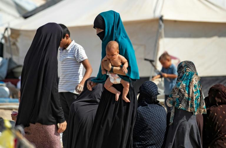 The women and children spent time in camps such as this one at al-Hol but France has taken them back under a 2014 accord with Turkey