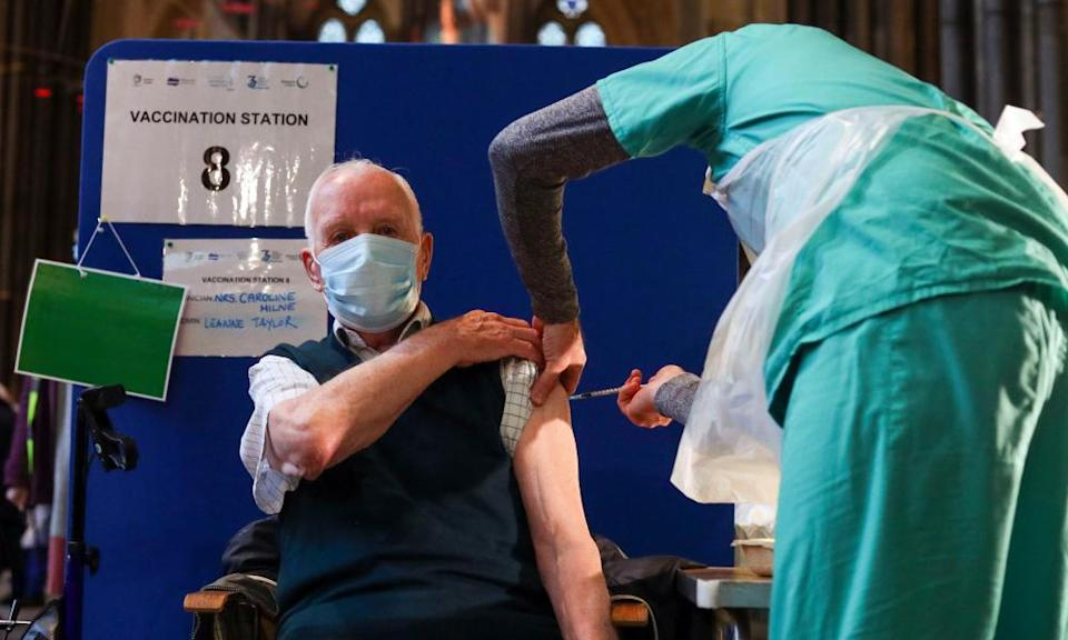 Louis Godwin receives an injection of the Pfizer coronavirus vaccine at Salisbury Cathedral.