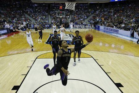 Mar 22, 2019; Columbus, OH, USA; Washington Huskies guard David Crisp (1) shoots the ball in the second half against the Utah State Aggies in the first round of the 2019 NCAA Tournament at Nationwide Arena. Mandatory Credit: Rick Osentoski-USA TODAY Sports
