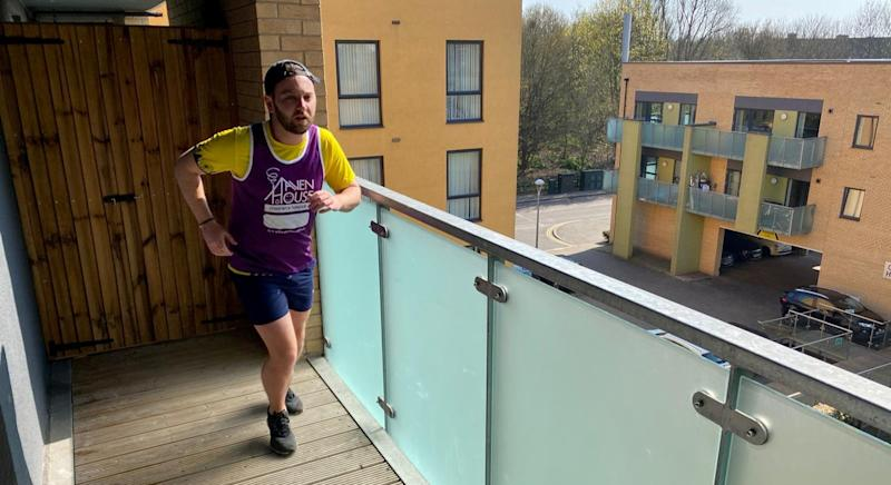 A runner has completed a half-marathon in self-isolation by jogging the length of his balcony 7,000 times (SWNS)