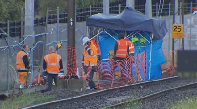Metro crews try to repair damage after overnight fire at Richmond. Photo: 7News