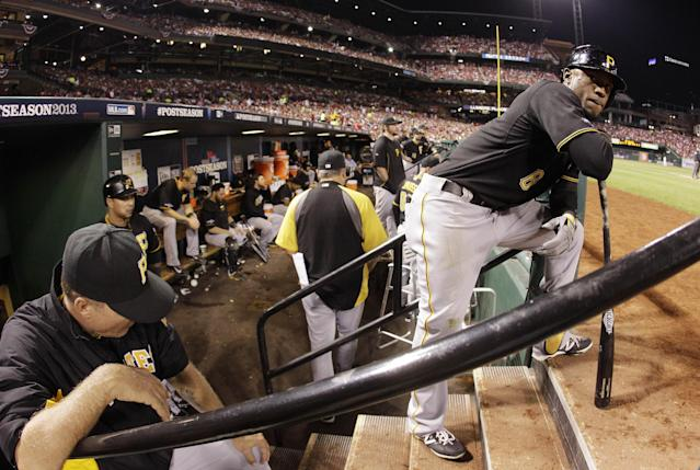 Pittsburgh Pirates left fielder Starling Marte (6) waits for his turn to bat against the St. Louis Cardinals in the sixth inning in Game 5 in a National League baseball division series on Wednesday, Oct. 9, 2013, in St. Louis. The Cardinals won 6-1. (AP Photo/Charlie Riedel)