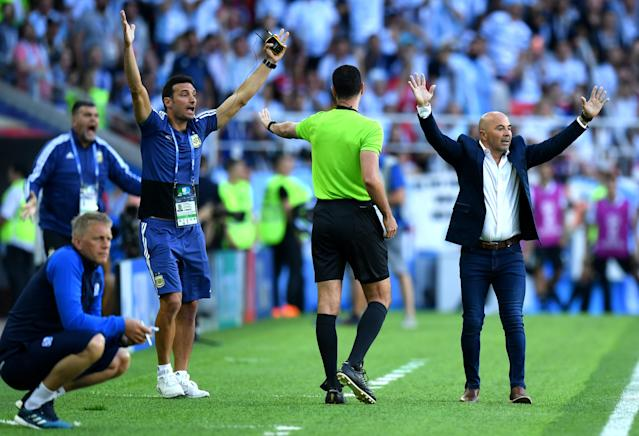 <p>The Argentina bench are certain they should have had a penalty before half-time – but the referee was unmoved </p>