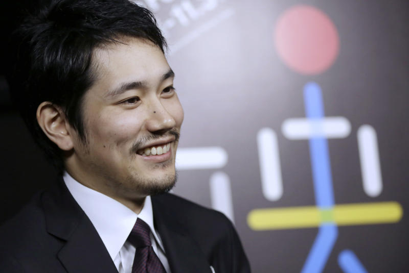 In this Nov. 2, 2016 photo, Japanese actor Kenichi Matsuyama is interviewed in Tokyo. The devotion Matsuyama gave to portraying a shogi prodigy who lived a fearlessly single-minded life is clear in the months he spent practicing placing the pawns in the Japanese board game, immersing himself in the master's selfless view on death and gorging to gain weight. (AP Photo/Eugene Hoshiko)