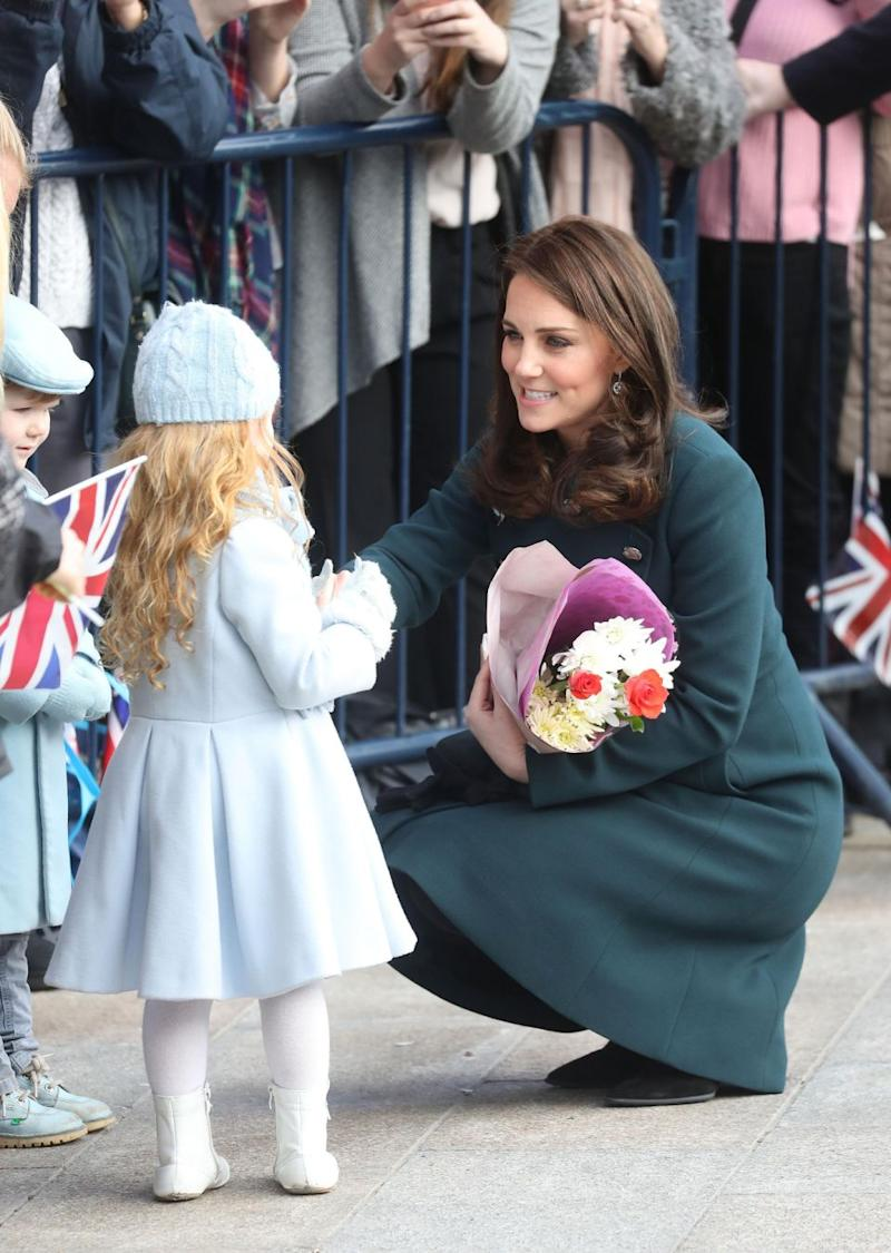 Despite her bump, Kate was seen crouching down to meet her littlest fans. Photo: Getty