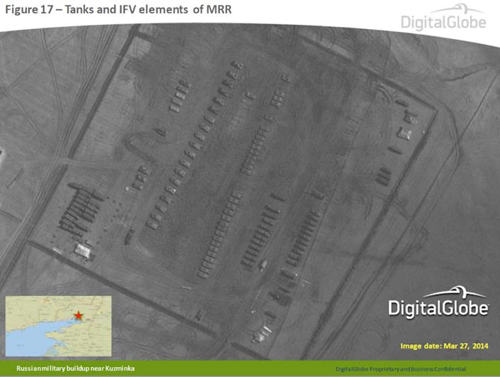 This satellite image made by DigitalGlobe on March 27, 2014, and provided by Supreme Headquarters Allied Powers Europe (SHAPE) on Tuesday, April 9, 2014, shows what are purported to be Russian military tanks and infantry fighting vehicles at a military base near Kuzminka, east of the Sea of Azov in southern Russia. The image is one of several provided to the AP by NATO's headquarters that show dozens of Russian tanks and other armored vehicles, combat jets and helicopter gunships stationed inside Russian territory near to the eastern border with Ukraine. AP cannot independently verify the authenticity or content of this image. (AP Photo/DigitalGlobe via SHAPE) MANDATORY CREDIT, NO CROPPING OR MODIFICATIONS ALLOWED