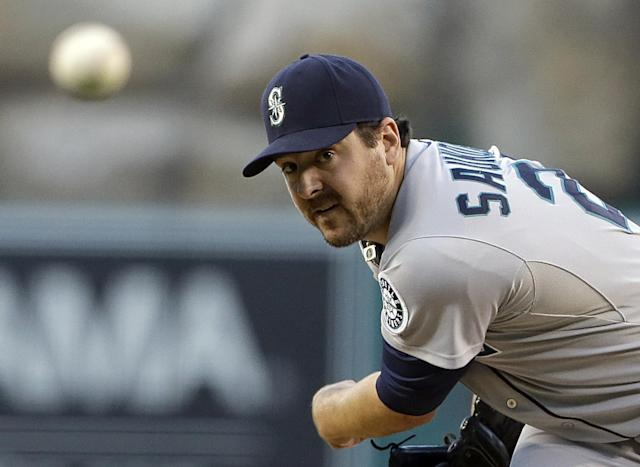 Seattle Mariners starter Joe Saunders pitches to the Los Angeles Angels in the first inning of a baseball game in Anaheim, Calif., Saturday, Sept. 21, 2013. (AP Photo/Reed Saxon)