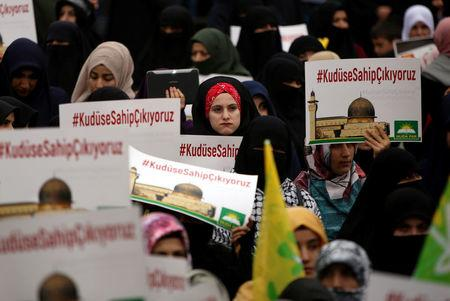"""Pro-Palestinian demonstrators hold banners that read """"We take care of Jerusalem"""" during a protest against the U.S. decision to recognise Jerusalem as the capital of Israel, in Diyarbakir, Turkey, December 17, 2017. REUTERS/Sertac Kayar"""