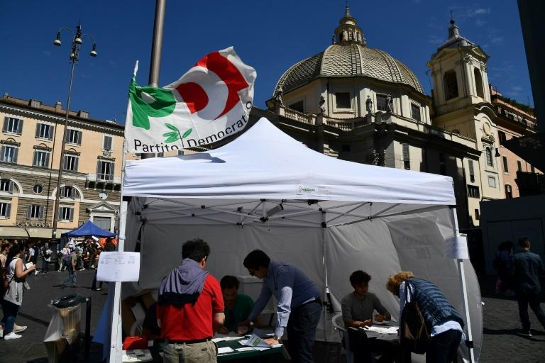Italians casting their ballots for the Democratic Party's leadership primary at a voting stand in Rome's Piazza del Popolo