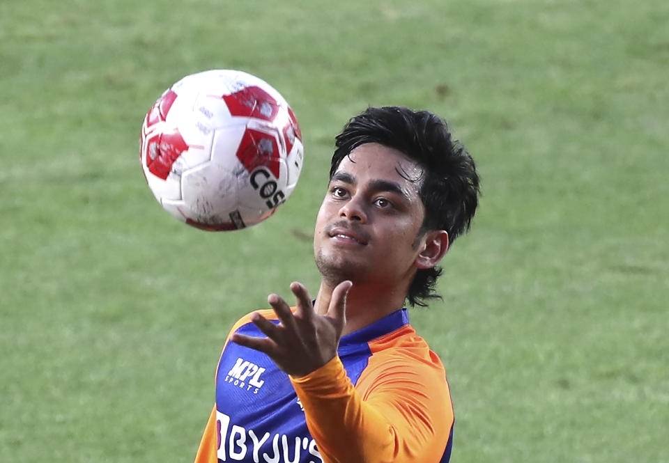 India's Ishan Kishan plays with a soccer ball during a training session ahead of the first Twenty20 cricket match between India and England in Ahmedabad, India, Monday, March 8, 2021. (AP Photo/Aijaz Rahi)