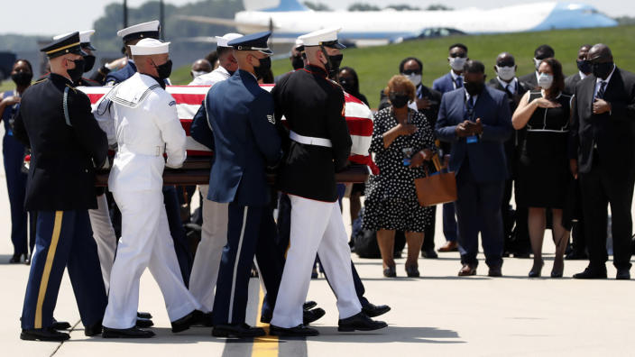 The casket of Rep. John Lewis, D-Ga., is carried by a joint services military honor guard to a hearse at Andrews Air Force Base, Md., on Monday. (AP Photo/Alex Brandon, Pool)