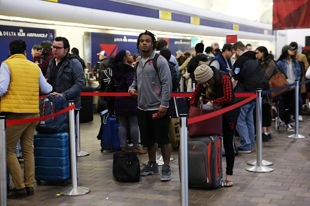 <p>Air travelers wait to check in during a winter nor'easter at LaGuardia Airport in New York, March 2, 2018. (Photo: Shannon Stapleton/Reuters) </p>