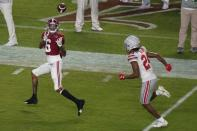 Alabama wide receiver DeVonta Smith catches a touchdown pass in front of Ohio State cornerback Shaun Wade during the first half of an NCAA College Football Playoff national championship game, Monday, Jan. 11, 2021, in Miami Gardens, Fla. (AP Photo/Wilfredo Lee)