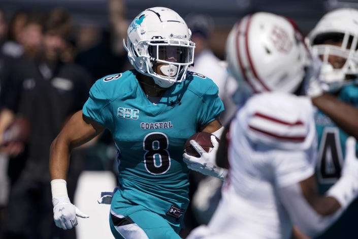 Coastal Carolina wide receiver Tyson Mobley runs for a touchdown against Massachusetts during the first half of an NCAA college football game on Saturday, Sept. 25, 2021, in Conway, S.C. (AP Photo/Chris Carlson)