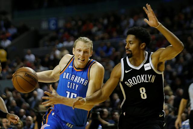 Basketball - NBA Global Games - Brooklyn Nets v Oklahoma City Thunder - Arena Mexico, Mexico City, Mexico December 7, 2017. Spencer Dinwiddie of Brooklyn Nets and Kyle Singler Oklahoma City Thunder in action. REUTERS/Carlos Jasso