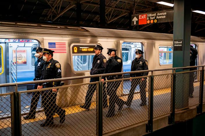 Metopolitan Transportation Authority Police walk the subway platform at the Coney Island station in Brooklyn, New York: AFP via Getty Images