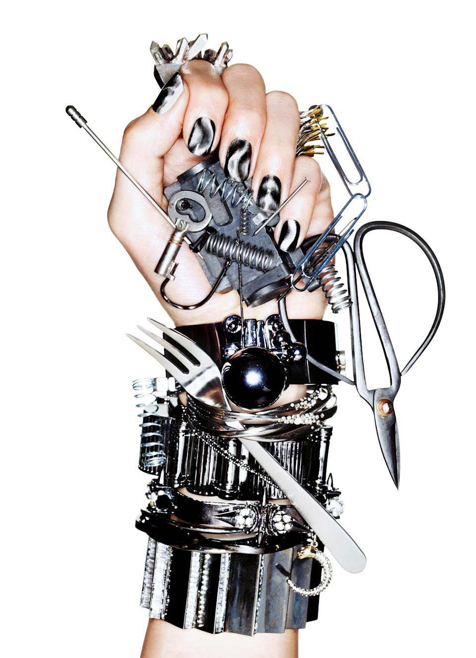 """<h1 class=""""title"""">IRON MAIDENNAILS INC. MAGNETIC ATTRACTION POLISH IN TRAFALGAR SQUARE. FROM TOP, RINGS BY OBLIK ATELIER AND PAMELA LOVE; CUFFS BY EDDIE BORGO, ALEXIS BITTAR, CC SKYE, FENTON, BCBGENERATION, AND SOO IHN KIM; NECKLACE WORN AS BRACELET BY STELLA & DOT. MANICU</h1><cite class=""""credit"""">Photographed by Ben Hassett, <em>Vogue</em>, October 2011</cite>"""