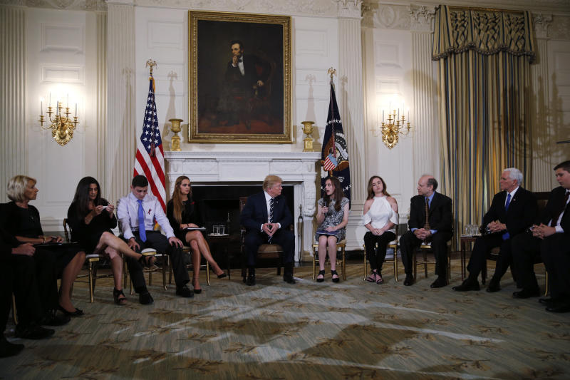 President Donald Trump hosts a listening session with high school students, parents and teachers to discuss school safety at the White House on Wednesday. (Jonathan Ernst / Reuters)