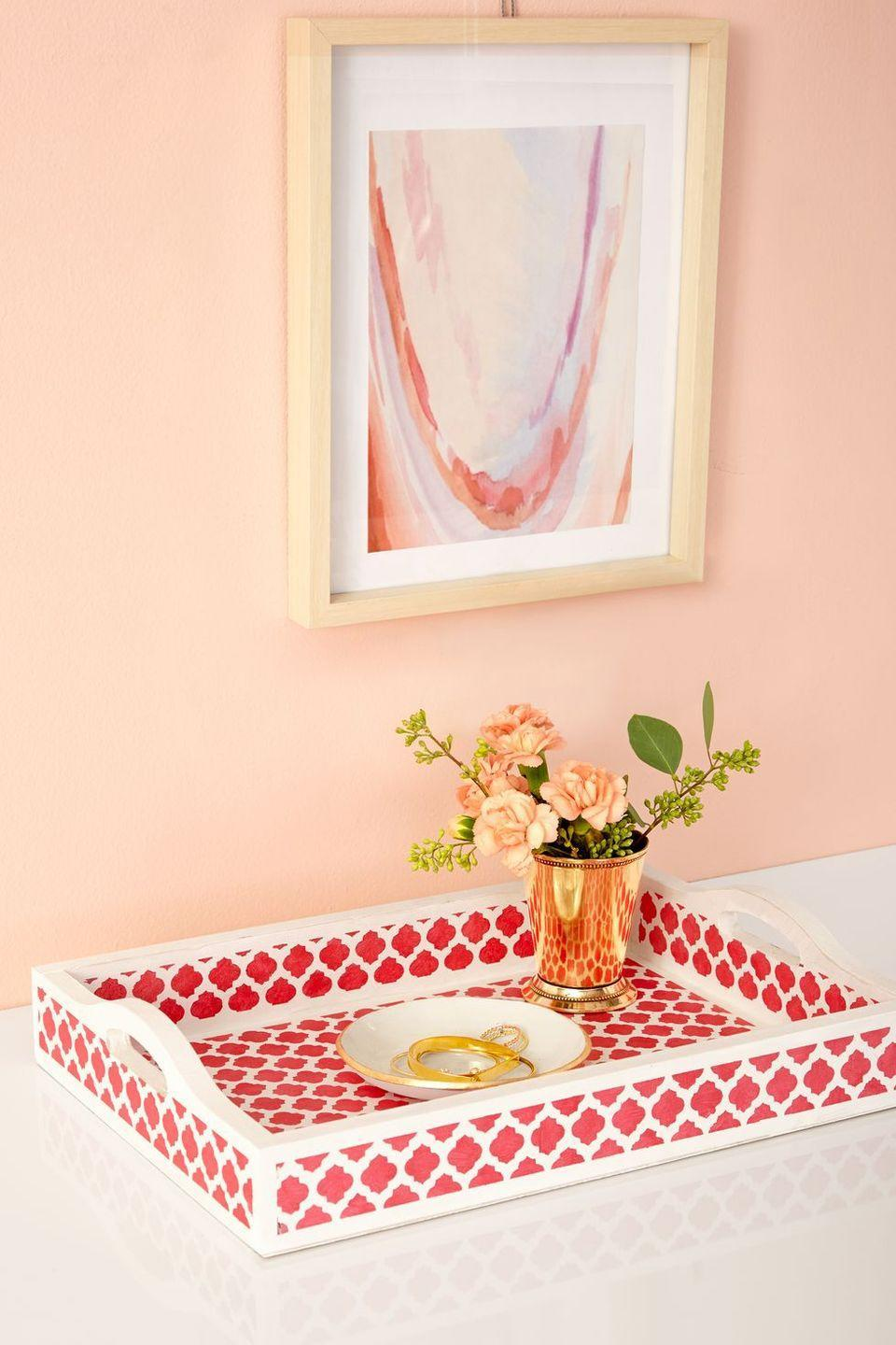 """<p>This delicate patterned tray is the perfect way to <a href=""""https://www.womansday.com/food-recipes/g2947/breakfast-in-bed/"""" rel=""""nofollow noopener"""" target=""""_blank"""" data-ylk=""""slk:serve Mom a tasty breakfast in bed"""" class=""""link rapid-noclick-resp"""">serve Mom a tasty breakfast in bed</a>. </p><p><strong><em><a href=""""https://www.womansday.com/life/g2913/easy-spring-crafts/?slide=3"""" rel=""""nofollow noopener"""" target=""""_blank"""" data-ylk=""""slk:Get the Patterned Tray tutorial"""" class=""""link rapid-noclick-resp"""">Get the Patterned Tray tutorial</a>. </em></strong></p>"""