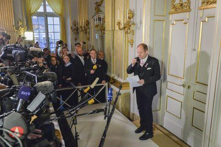 Peter Englund, permanent secretary of the Swedish Academy, steps out of his office to announce French writer Patrick Modiano as the winner of the 2014 Nobel Prize for Literature in Stockholm October 9, 2014. REUTERS/Anders Wiklund/TT News Agency