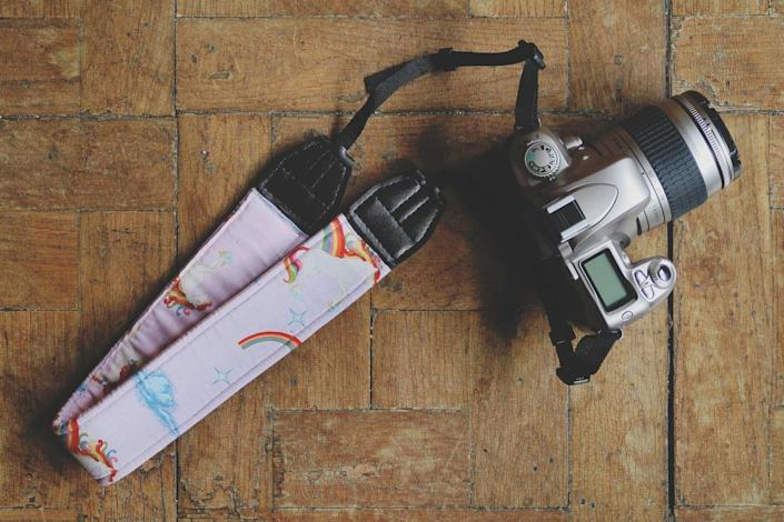 <p>This handmade <span>ParpelSpiral Unicorn Digital SLR Camera Strap</span> ($22, originally $25) doubles as a fashionable accessory.</p>