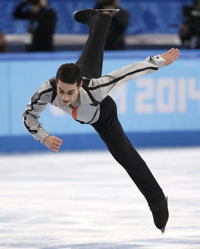 Javier Fernandez of Spain competes in the men's free skate figure skating final at the Iceberg Skating Palace during the 2014 Winter Olympics, Friday, Feb. 14, 2014, in Sochi, Russia. (AP Photo/Bernat Armangue)