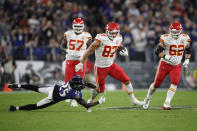 Kansas City Chiefs tight end Travis Kelce (87) rushes past Baltimore Ravens cornerback Tavon Young in the second half of an NFL football game, Sunday, Sept. 19, 2021, in Baltimore. (AP Photo/Nick Wass)
